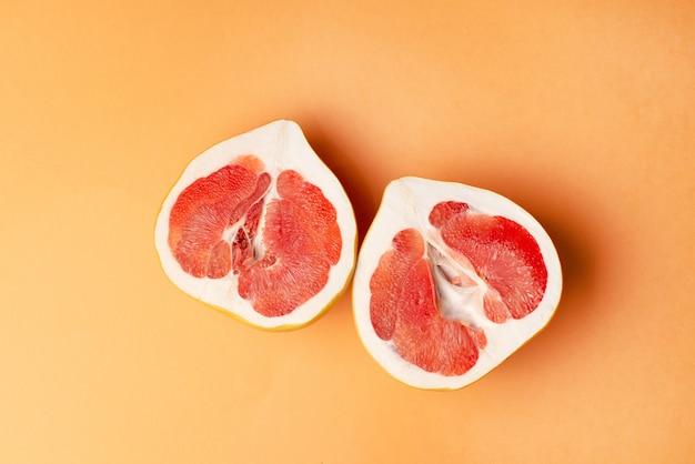Fresh grapefruit on orange Premium Photo