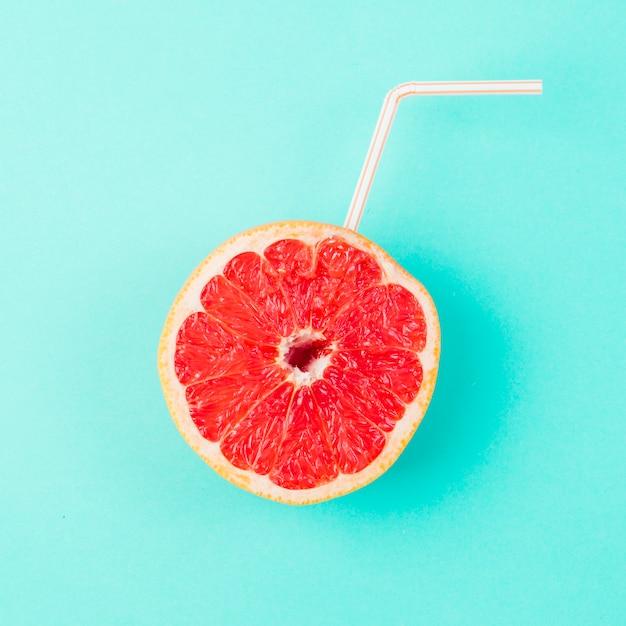 Fresh grapefruit with straw Free Photo