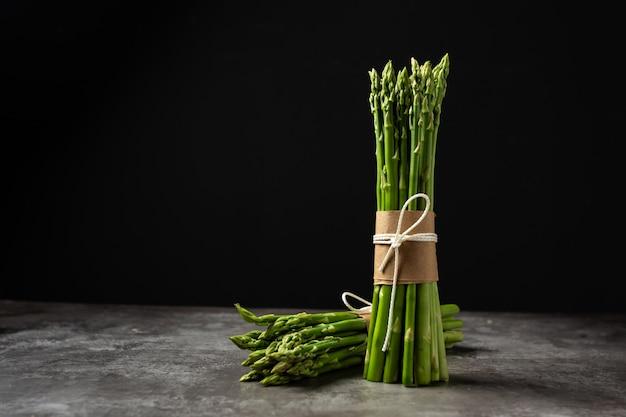 Fresh green asparagus on table. Free Photo