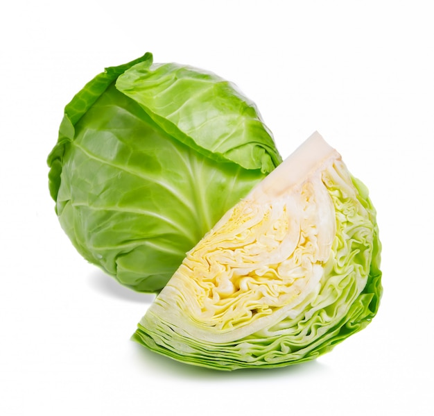 Fresh green cabbage and chopped part isolated Premium Photo