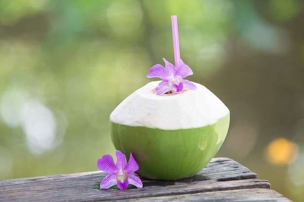 Fresh green coconuts with drinking straw Premium Photo