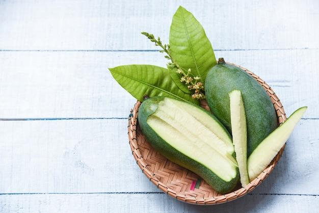 Fresh green mango and green leaves basket Premium Photo