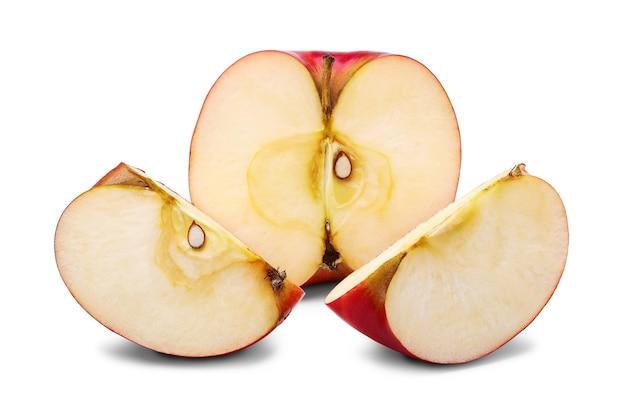 Свежая половина и два ломтика яблока с косточкой Premium Фотографии