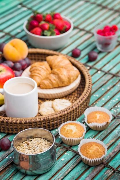 Fresh healthy breakfast on wooden background Free Photo