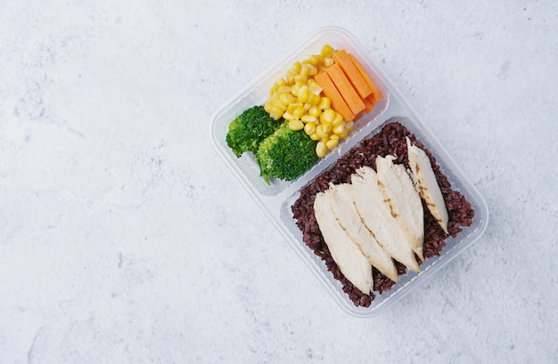 Fresh healthy diet lunch box with broccoli, carrot; corn and chia Premium Photo