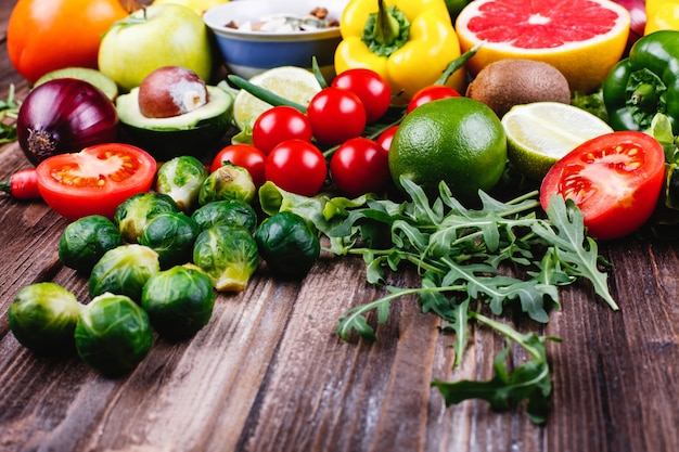 Fresh and healthy food. avocabo, brussel sprouts, cucumbers, red, yellow and green peppers Free Photo