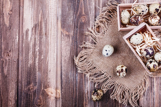 Fresh and healthy food, protein. quail eggs in wooden box stand on the rustic table Free Photo