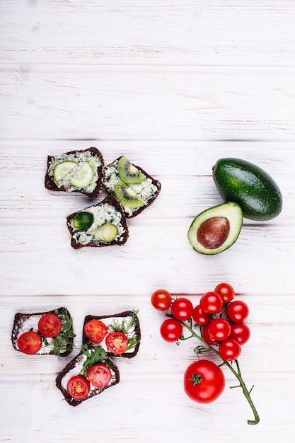 Fresh and healthy food. snack or lunch ideas. homemade bread with cheese, avocado Free Photo