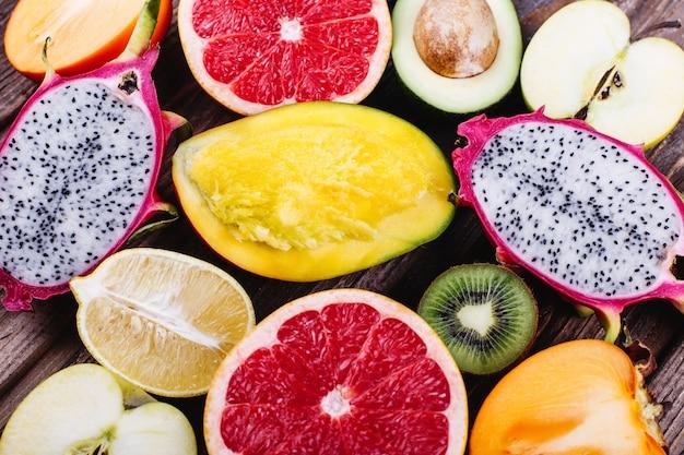 Fresh and healthy food, vitamins. pieces of dragon fruit, pomelo, lemons, lime, avocado Free Photo