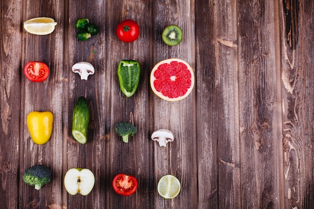 Fresh and healthy food. yellow and green pepper, lemon, lime, broccoli, tomatoes Free Photo