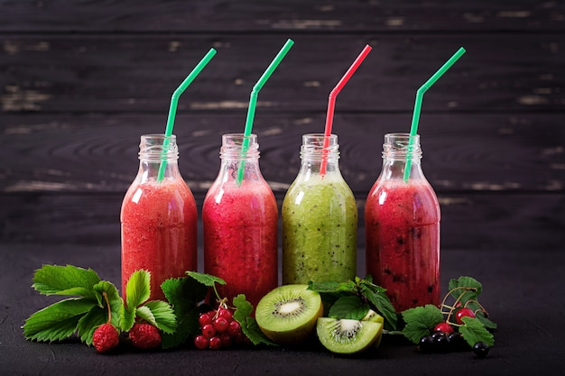 Fresh healthy smoothies from different berries on a dark background. Diet menu. Premium Photo