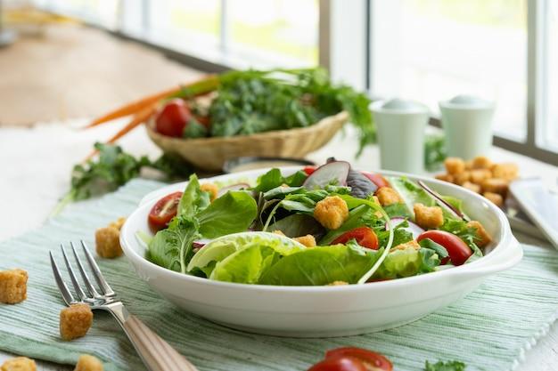 Fresh healthy vegetable caesar salad on plate with sauce. Premium Photo