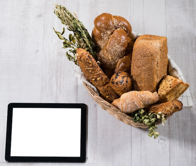 Fresh homemade bread with tablet Premium Photo