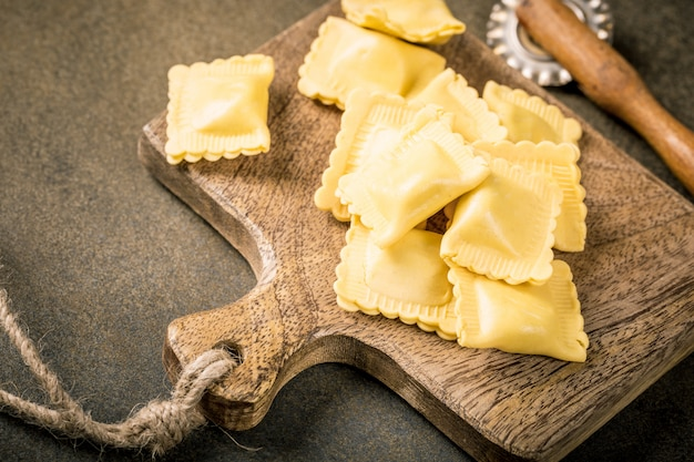 Fresh homemade filled square pasta ravioli Premium Photo