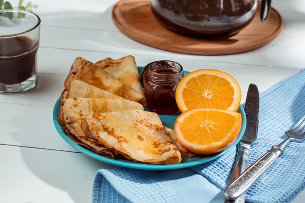 Fresh homemade french crepes made with eggs, milk and flour, filled with marmalade on a vintage plate Free Photo