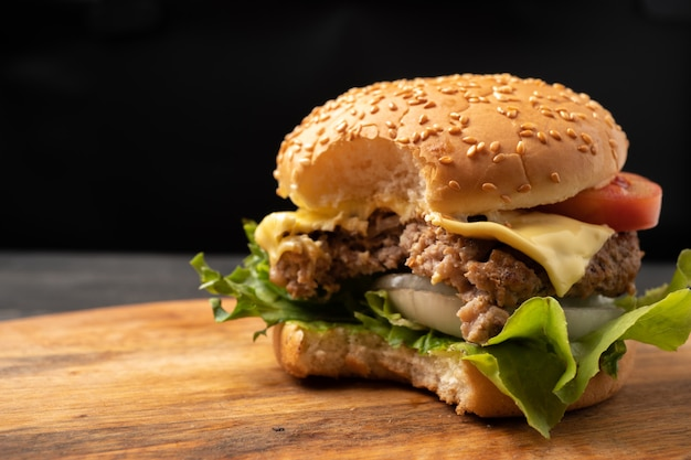 Fresh homemade hamburgers, delicious fresh vegetables that are bitten on a cutting board Premium Photo