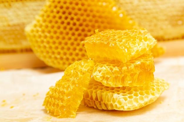 Fresh honeycombs on a light . Premium Photo
