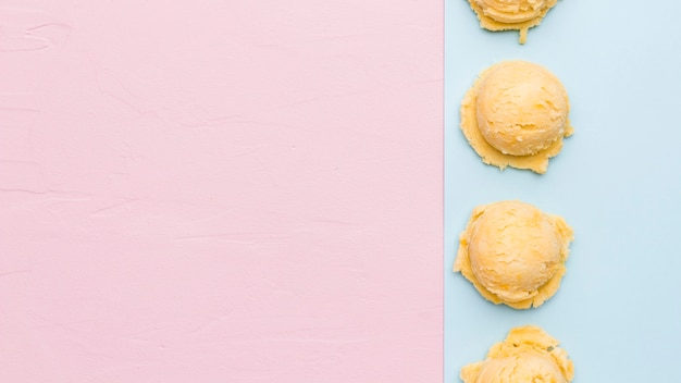 Fresh ice cream scoop on multicolored surface Free Photo