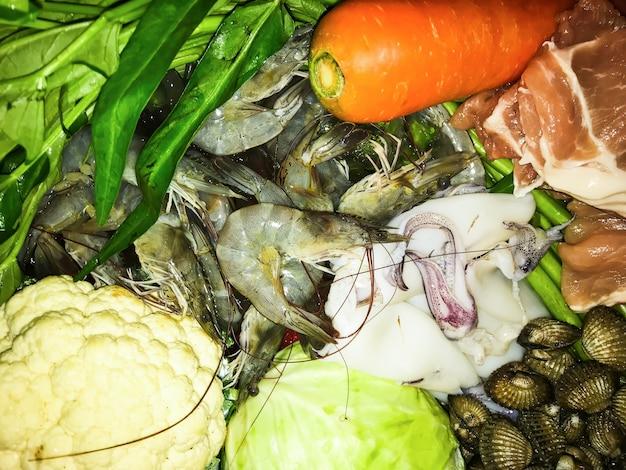 Fresh ingredient of shabu or suki as follows shrimp Premium Photo