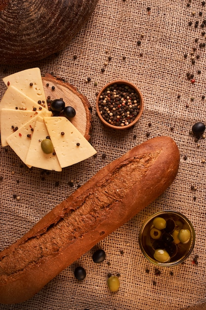Fresh italian baguette on wooden table with oil.selective and soft focus Premium Photo