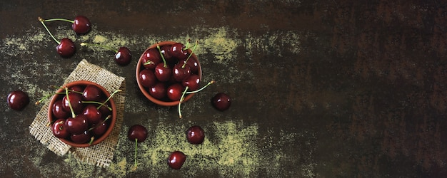 Fresh large sweet cherries. sweet cherries in bowls. vitamin concept. Premium Photo