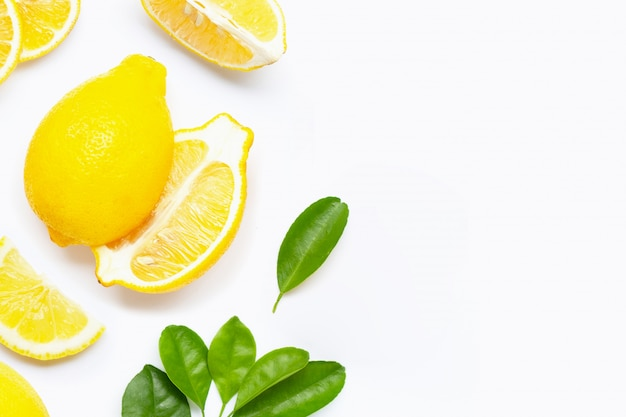 Fresh lemon with slices isolated on white. Premium Photo