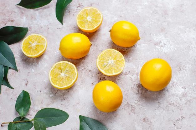 Fresh lemons on light surface,top view Free Photo