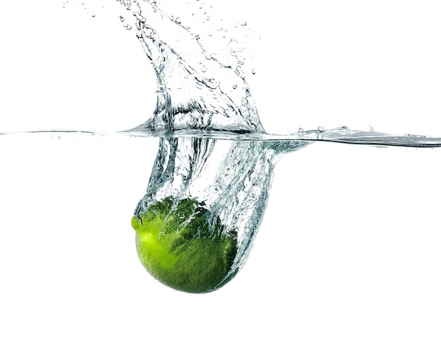 Fresh lime falling into water Free Photo