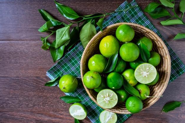 Fresh lime in green basket Premium Photo