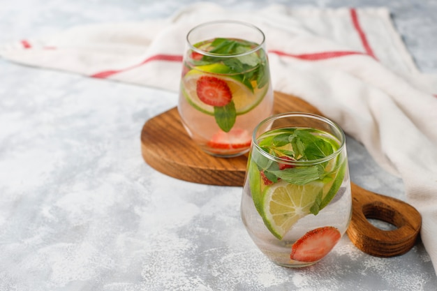 Fresh lime, strawberry and mint infused water, cocktail, detox drink, lemonade. summer drinks. health care concept. Free Photo