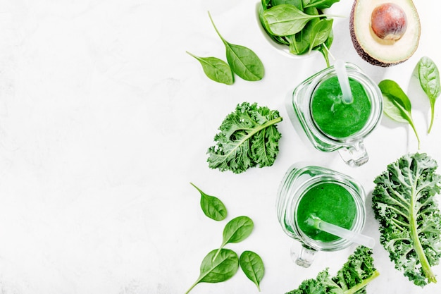 Fresh made green smoothie in bottle Free Photo