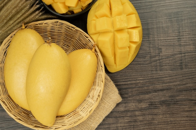 Fresh mango top view. wooden background and copy space for add text. Premium Photo