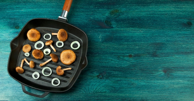 Fresh mushrooms with spices and herbs on black board Premium Photo