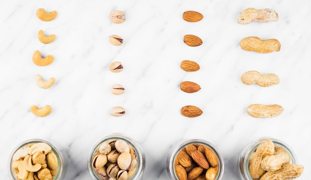 Fresh nut food in jar on marble surface Free Photo