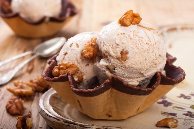Fresh nut ice cream in waffle cup Premium Photo