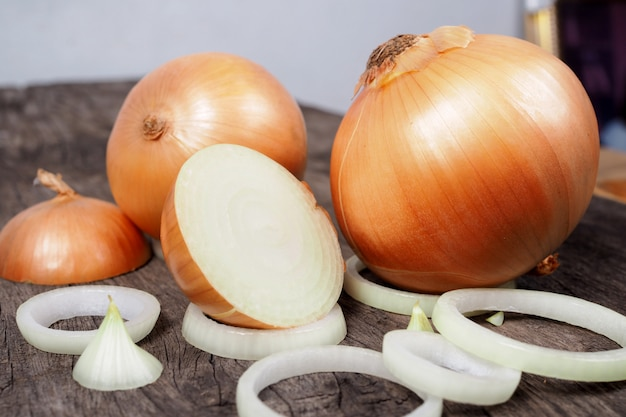 Fresh onion and onion slices on old wooden table background. nature food Premium Photo