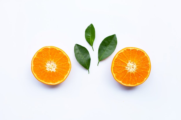 Fresh orange citrus fruits with leaves on white background. Premium Photo