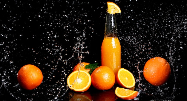 Fresh orange drink with splashes of water Free Photo