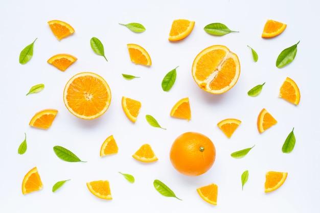 Fresh orange fruit with green leaves  on white. Premium Photo