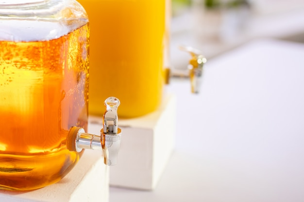 Fresh orange juice in the mason jar on wood table Premium Photo