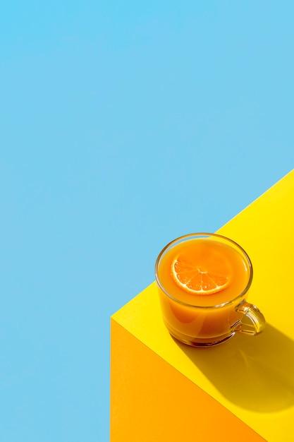 Fresh orange smoothie on the corner of a table Free Photo