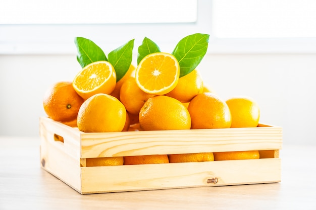 Fresh oranges fruit on table Free Photo