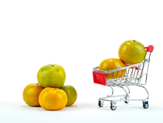 The fresh oranges and shopping cart, basket shopping concept with white background Premium Photo