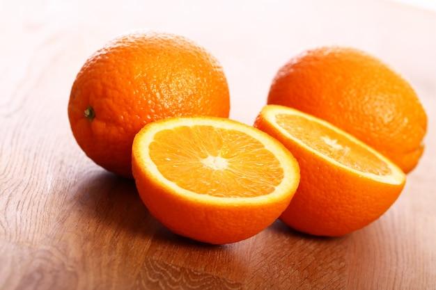Fresh oranges on wooden board Free Photo