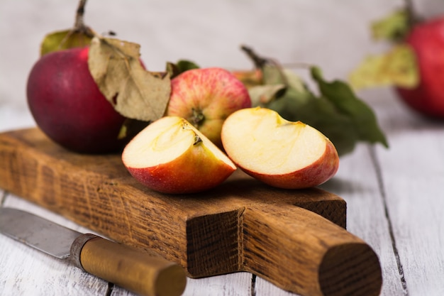 Fresh organic apples on wooden board Premium Photo