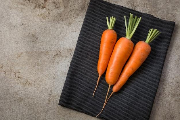 Fresh organic carrot on rustic vintage table. Premium Photo