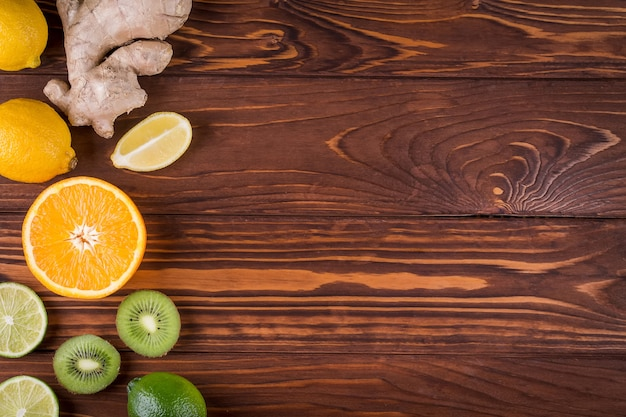 Fresh organic citrus fruits and on wooden background. healthy food and healthy life concept. top view Premium Photo