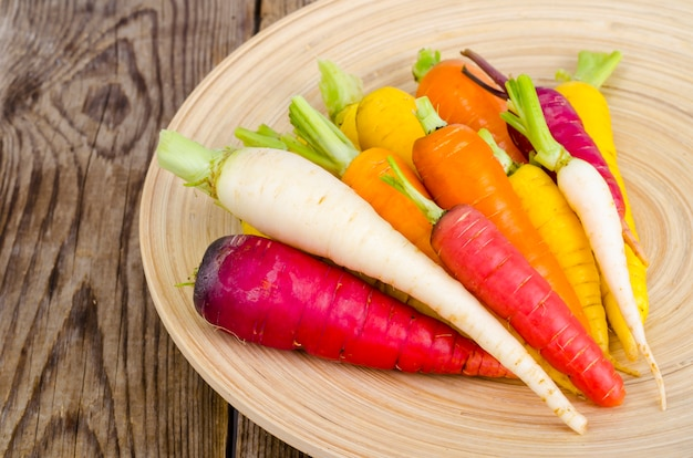 Fresh organic farm carrots of various types and colors Premium Photo