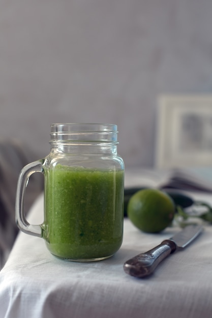 Fresh organic green smoothie with spinach, cucumber on a white tableware Premium Photo