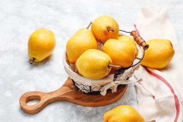 Fresh organic pears on white grey concrete . selective focus. Free Photo